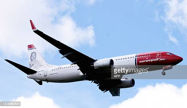 A file photo taken on July 17 2009 shows a Boeing 737800 of Lowcost airline Norwegian flying near Oslo airport in Gardermoen Norwegian said on...