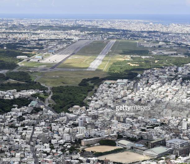 File photo taken on July 24 shows the US Marine Corps Air Station Futenma in Ginowan in Japan's southern island prefecture of Okinawa A piece from a...