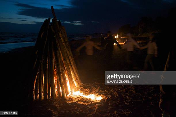 A file photo taken on June 23 2008 shows Latvians dancing around a midsummer's night fire in Tuja They may be suffering from one of the world's worst...