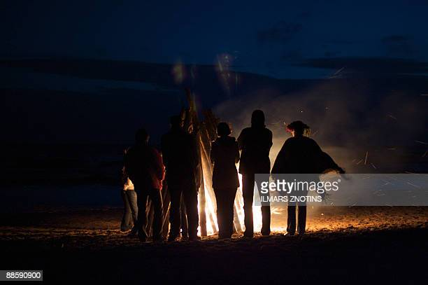 A file photo taken on June 23 2008 shows Latvians gathering around a midsummer's night fire in Tuja They may be suffering from one of the world's...