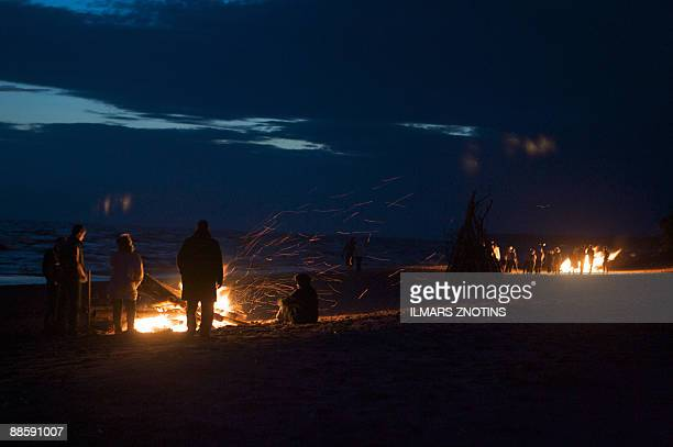 A file photo taken on June 23 2008 shows Latvians gathering around a midsummer's night fires in Tuja They may be suffering from one of the world's...