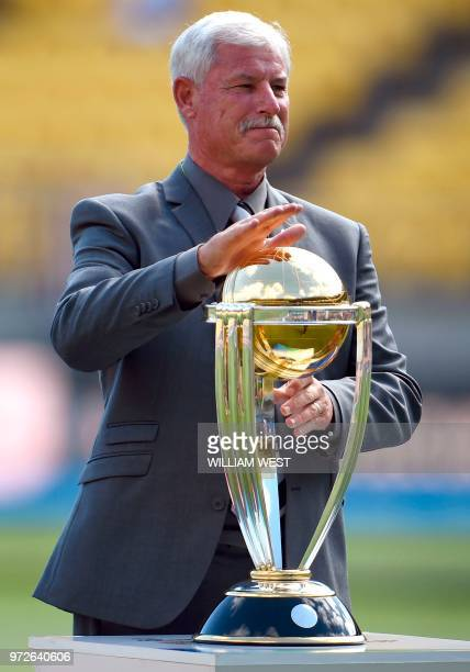 A file photo taken on March 1 shows New Zealand cricket legend Richard Hadlee with the Cricket World Cup trophy before the start of the 2015 Cricket...