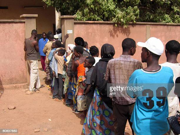A file photo taken on March 24 2007 shows people standing in line to get vaccinated against meningitis in a medical center in Ouagadougou A...