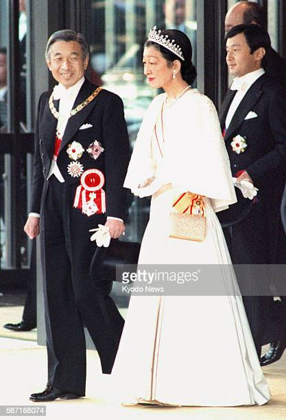 File photo taken on Nov 12 shows Japanese Emperor Akihito and Empress Michiko leaving the Imperial Palace for the celebration parade of his...