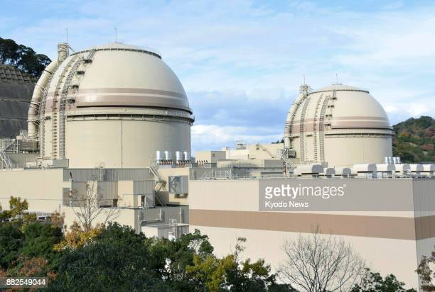 File photo taken on Nov 25 shows the No 3 and No 4 reactors of Kansai Electric Power Co's Oi nuclear power plant in Oi in central Japan's Fukui...