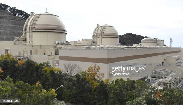 File photo taken on Nov 26 shows the Nos 1 3 and 4 reactors of Kansai Electric Power Co's Oi nuclear plant in Oi Fukui Prefecture ==Kyodo
