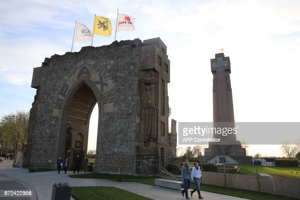 A file photo taken on November 11 shows people walking next to the Yser Tower and the Pax Gate during the 87th Ijzerbedevaart yearly pilgrimage in...