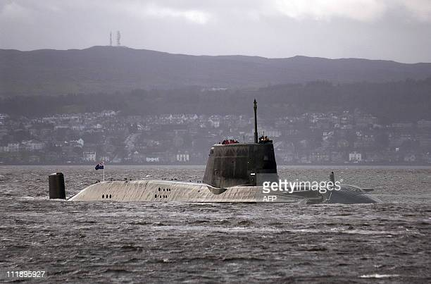 File photo taken on November 20 shows the British Royal Navy's nuclear submarine, HMS Astute, en-route to her new base Faslane, on the Firth of Cylde...