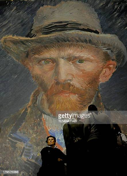 A file photo taken on October 9 2010 shows visitors standing in front of a selfportrait of Dutchborn painter Vincent van Gogh at the Vittoriano...