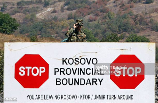 A file photo taken on September 17 2011 shows a German soldier with the NATOled peacekeepers in the KFOR force standing guard at the Jarinje border...