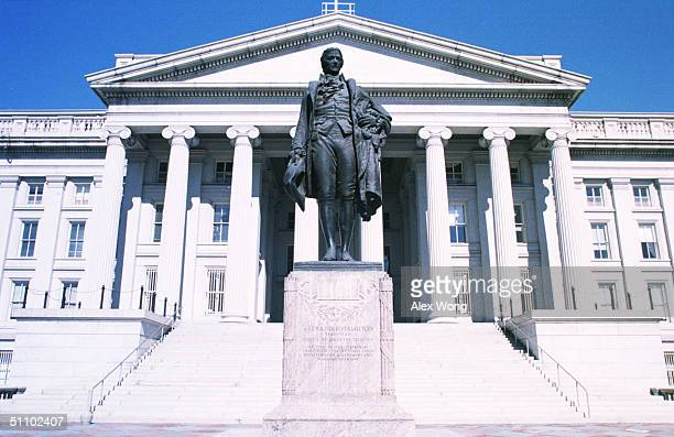 The Sculpture Of Alexander Hamilton, The First Secertary Of The Treasury, Stands In Front Of The Treasury Department Building In Washington Dc,...