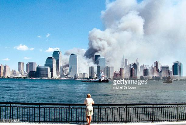 The view of the Manhattan skyline after a terrorist attack which destroyed the Twin Towers of the World Trade Center A lone spectator watches the...