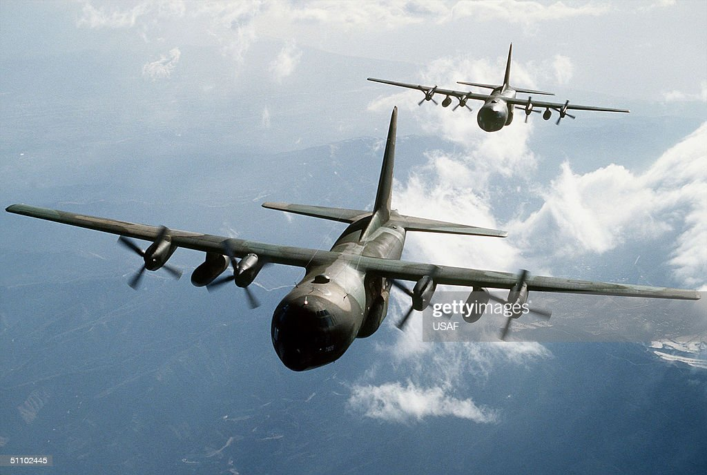 Two C 130E Hercules Aircraft Flying Over Mountainous Terrain : News Photo