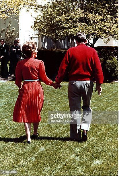 US President Ronald Reagan And Mrs Nancy Reagan Stroll Through The White House Rose Garden On April 16 1981