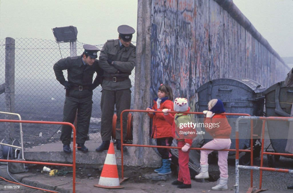 West German School Children On The Way To School Come Across The Berlin Wall Being Opened With Two East German Border Guards During The Collapse Of Communism In East Berlin On November 14, 1989. November, 1999 Marks The 10Th Anniversary Of The Fall Of The Berlin Wall. East Germany's Communist Government Erected The Berlin Wall In August 1961. The Wall Fell After Weeks Of Massive Anti-Government Protests On November 9, 1989. The Fall Of The Berlin Wall Is Often Described As The 'End Of The Cold War.' East German Border Guards Shot 77 People Who Tried To Escape To The West Over The Wall During The Course Of Its Existence.
