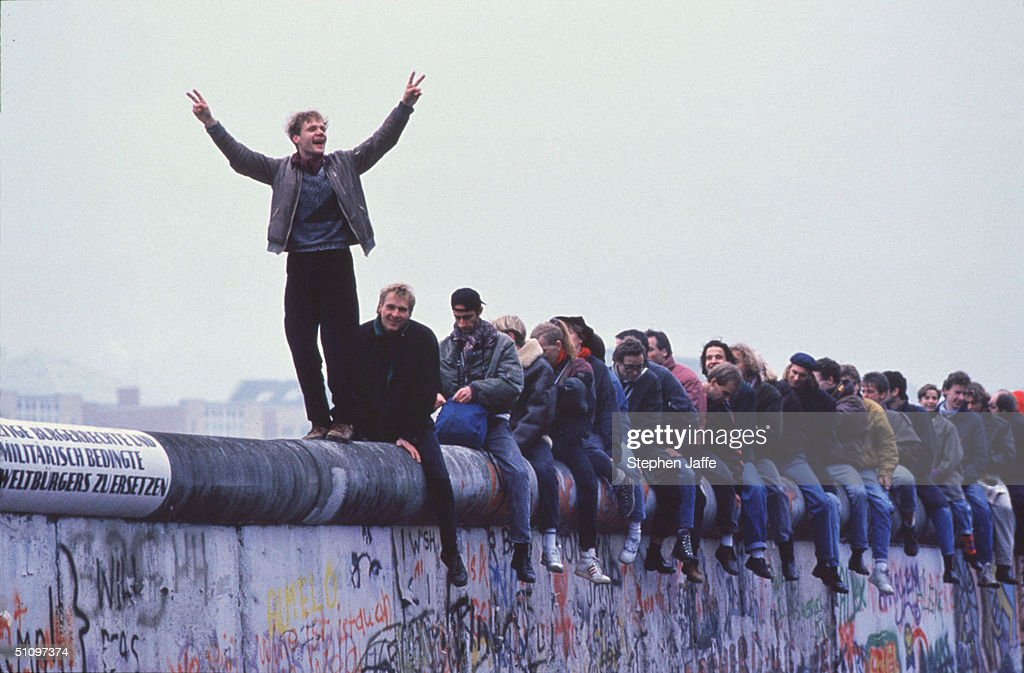 West Germans Celebrate The Unification Of Berlin Atop The Berlin Wall During The Collapse Of Communism In East Berlin On November 12, 1989. November, 1999 Marks The 10Th Anniversary Of The Fall Of The Berlin Wall. East Germany's Communist Government Erected The Berlin Wall In August 1961. The Wall Fell After Weeks Of Massive Anti-Government Protests On November 9, 1989. The Fall Of The Berlin Wall Is Often Described As The 'End Of The Cold War.' East German Border Guards Shot 77 People Who Tried To Escape To The West Over The Wall During The Course Of Its Existence.