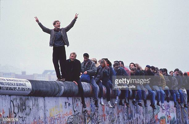 West Germans Celebrate The Unification Of Berlin Atop The Berlin Wall During The Collapse Of Communism In East Berlin On November 12 1989 November...