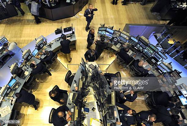 File photograph dated May 6 2010 shows traders on the floor of the New York Stock Exchange looking at stocks during the final minutes of trading as...