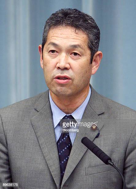 A file photograph shows Tsutomu Sato chairman of the National Public Safety Commission speaking during a news conference at the prime minister's...