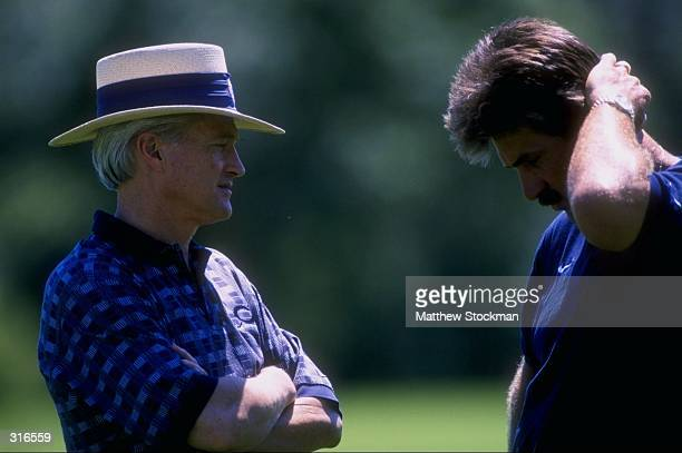 20 Jul 1998 Michael B McCaskey and Chicago Bears head coach Dave Wannstedt talk during the Chicago Bears Training Camp in Lake Forest Illinois...
