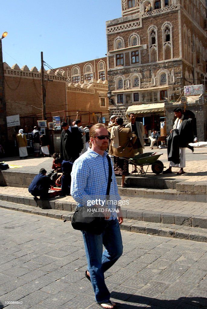 -- File picture date January 19, 2010 shows a Western tourist walking in the streets of Sanaa's Old City. Tribesmen abducted a Western couple and their Yemeni driver on May 24, 2010 in Bani Mansour, 70 kilometres (45 miles) west of the capital, a tribal source told AFP.