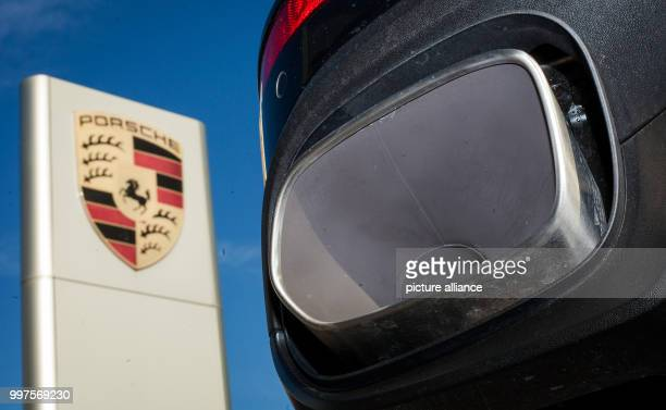 FILE A file picture dated 04 November 2015 shows the exhaust of a Porsche Cayenne next to the Porsche logo in Stuttgart Germany Photo Christoph...