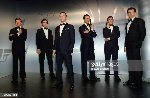 File picture dated 04 October 2016 showing the wax statues of actors Roger Moore , Timothy Dalton, Daniel Craig, Sean Connery, George Lazenby and...