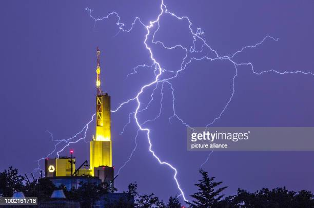 FILE  File picture dated 07 June 2016 showing lightning appearing amidst a nighttime sky over the headquarters of Commerzbank in Frankfurt am Main...