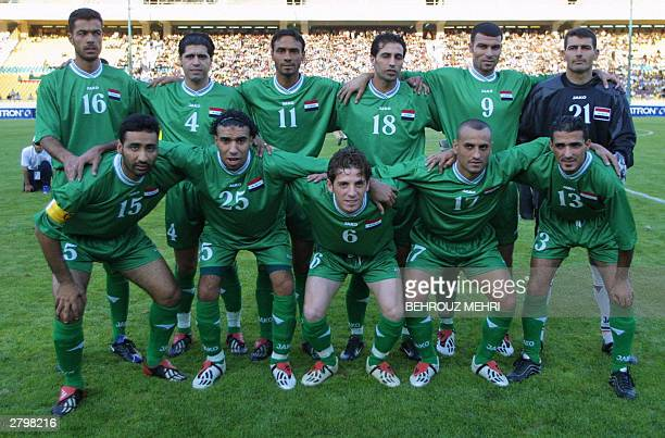 File picture dated 13 August 2003 shows Iraq's national footbal team posing for a group photo before their match against Iran during the LG Peace Cup...