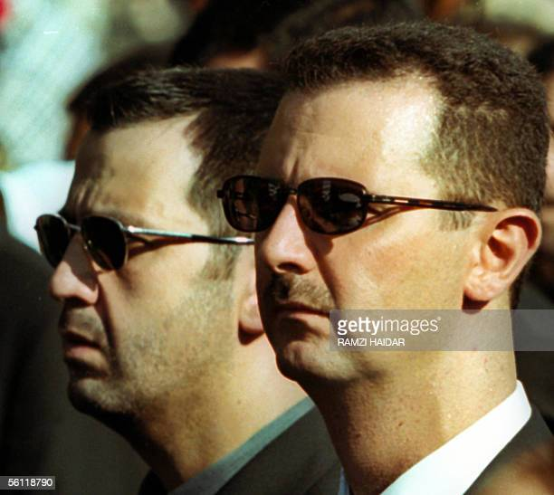 A file picture dated 13 June 2000 shows Syrian President Bashar alAssad and his brother Maher during the funeral of their father Syria's late...