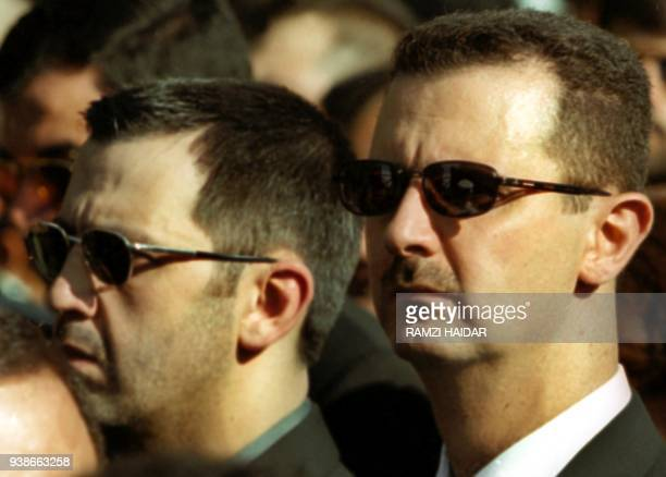 A file picture dated 13 June 2000 shows Syrian President Bashar alAssad and his younger brother Maher chief of the presidential guard during the...