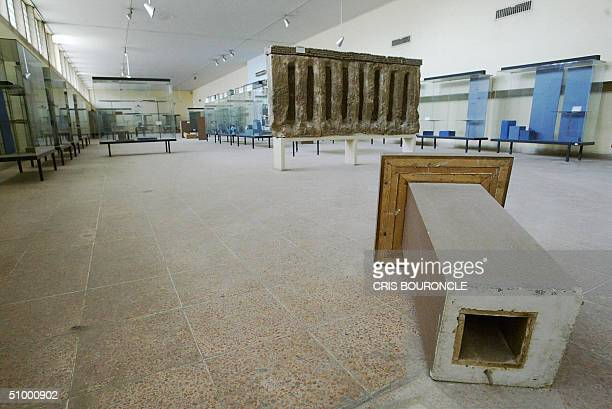 MUSEUM A file picture dated 13 March 2004 shows empty glass cabinets and an artefact stand still on the ground inside Iraq's national museum in...