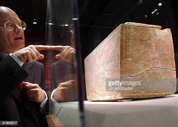 -- File picture dated 14 November 2002 shows Meir Romem, Israel's consul general in Canada, inspecting the James Ossuary during the unveiling of the...