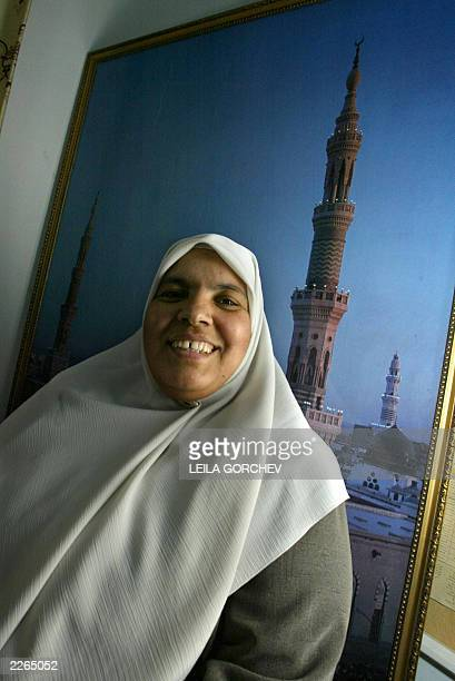 File picture dated 17 May 2003 shows Hayaat alMassimi posing for a photograph near a poster of Medina's Masjid alNabawi or the Prophet's Mosque in...