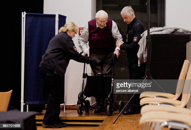 File picture dated 23 April 2015 showing the accussed Oskar Groening arriving to a courtroom using a walking frame in Lueneburg, Germany.Former SS...