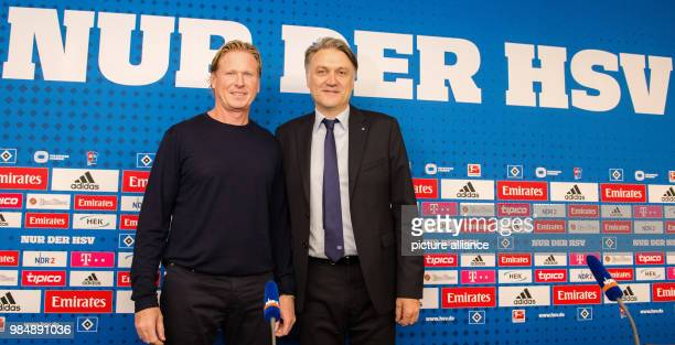 FILE  File picture dated 26 September 2016 showing Hamburger SV's new head coach Markus Gisdol smiling and standing next to the club's thenchairman...