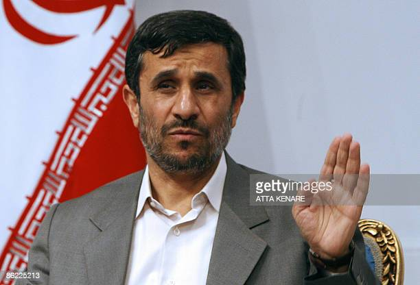 File picture dated April 19 2009 shows Iranian President Mahmoud Ahmadinejad during a welcoming ceremony for former Turkish prime minister Necmettin...