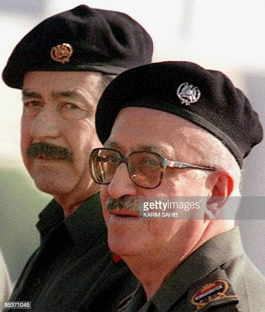 File picture dated August 3 1998 shows Iraq's former deputy prime minister Tareq Aziz standing next to Saddam Hussein's hatchetman Ali Hassan alMajid...