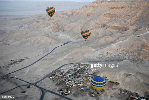A file picture dated November 15 2007 shows tourist hot air balloons flying during dawn across Egypt's Valley of the Kings near Luxor The ornate...