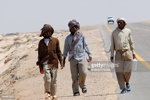 A file picture dated November 2 2007 shows Somali refugees walking on the side of the main road near the Yemeni town of Ahwar Somali refugees who...