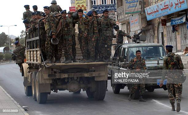 File picture dated September 20 2008 shows Yemeni soldiers patroling a street on their way to the British and US embassies to tighten security in...