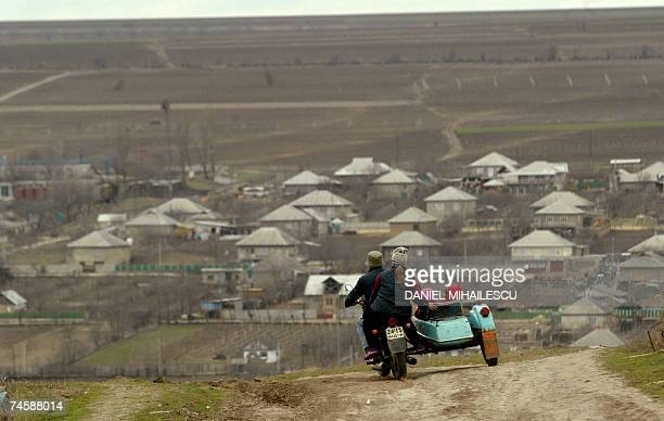 File picture of a local family travelling by motorcycle around the village of Mingir 80km southwest from Chisinau 22 March 2007 Almost 80 percent of...