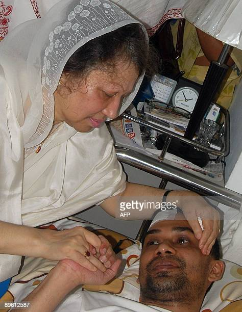 File picture of former Bangladeshi prime minister Khaleda Zia holding the hand of her ailing son Tareque Rahman at a hospital after her release from...