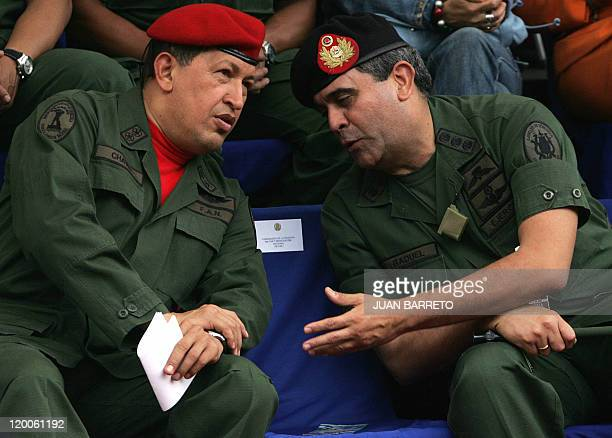File picture of Venezuelan President Hugo Chavez as he chats with Defense minister General Raul Isaias Baduel during the inauguration ceremony of the...