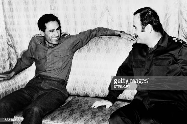 File picture released on December 1973 shows Libyan leader Colonel Moamar Kadhafi meeting his Syrian counterpart at the time Hafez alAssad in...
