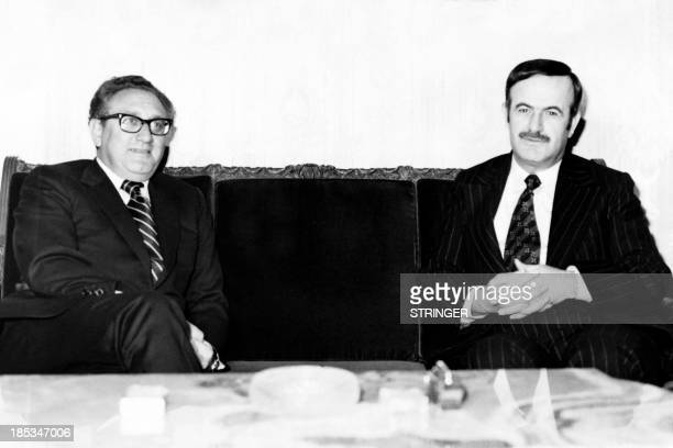 File picture released on January 30 1974 shows US Secretary of State Henry Kissinger meeting Syrian President Hafez alAssad in Damascus AFP PHOTO/STR...