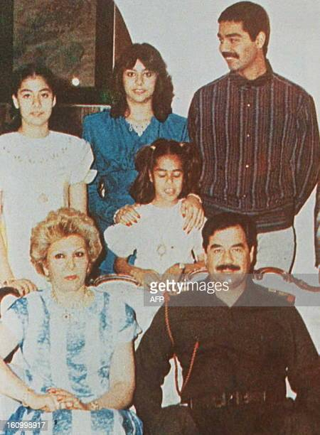 File picture showing Iraqi President Saddam Hussein surrounded by his first wife Dajiba his eldest son Uday and his two sisters Rana and Raghad dated...