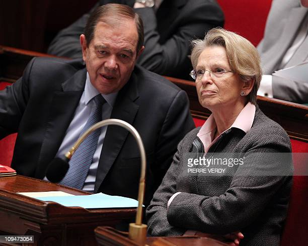 A file picture shows French deputy minister for Parliamentary relations Patrick Ollier and his wife France's Foreign Affairs Minister Michele...