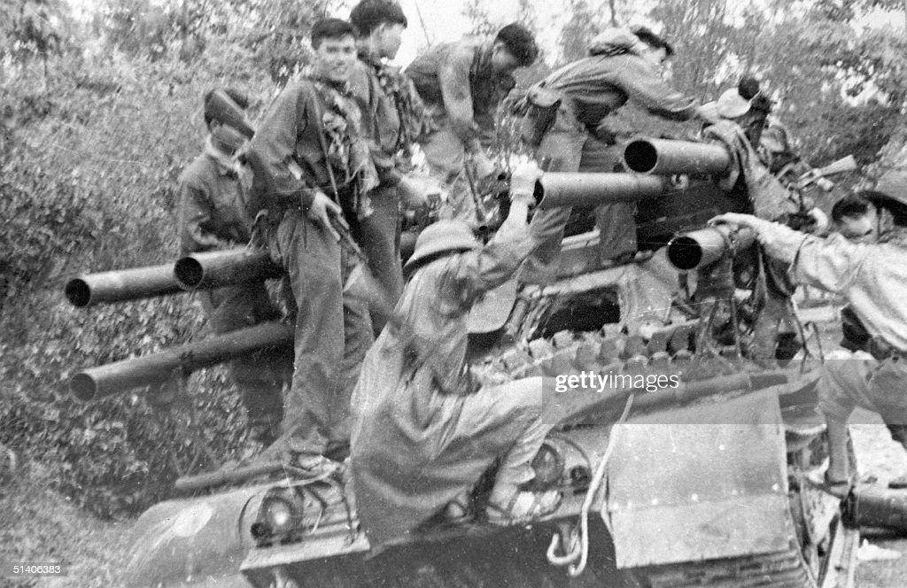 File picture shows Vietcong soldiers climbing onto a US tank abandoned on a road in Hue in 1968 during the Tet general offensive. This week sees the 30th anniversary of the offensive, a surprise attack on nearly 100 targets in South Vietnma that marked a turning point in the Vietnam war.