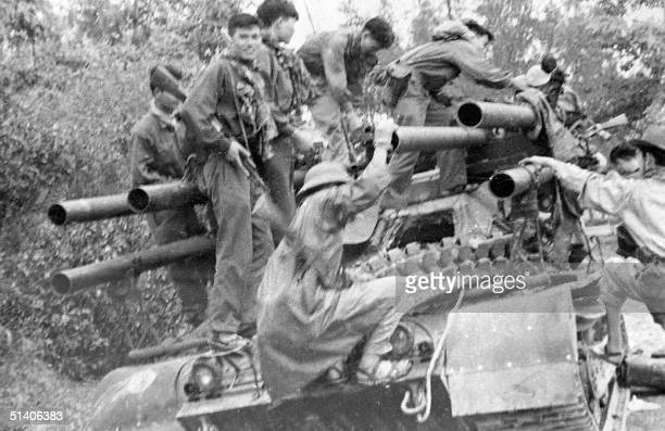 File picture shows Vietcong soldiers climbing onto a US tank abandoned on a road in Hue in 1968 during the Tet general offensive This week sees the...
